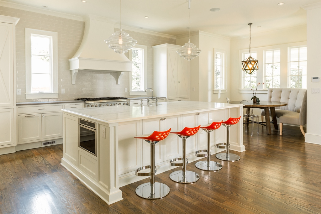 The 2017 Atlanta Urban Design Commission. Bright kitchen space with over-scaled island.