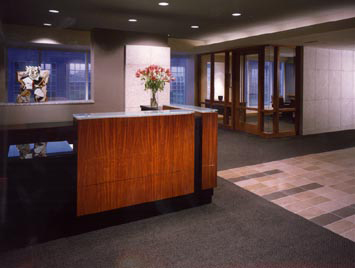 Pope & Land Reception Desk At Entry