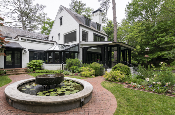 porch incorporated into gardens and backyard